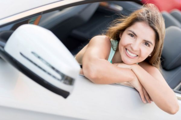 lady smiling in car